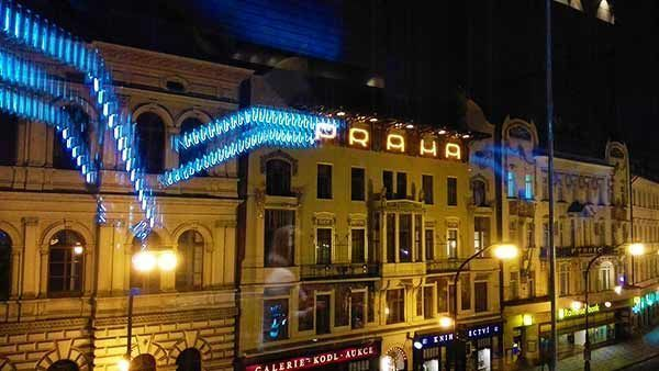 Sign Praha in mirror with blue neon light