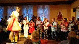 Having fun while dancing in evening folk show