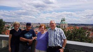 Family trip to Prague, at Prague Castle overlooking city below