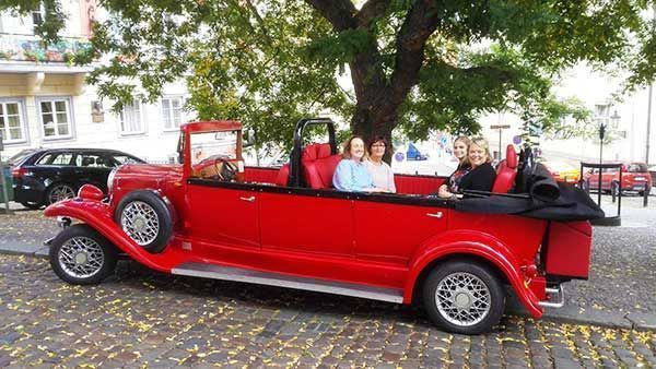 4 friends from USA with Prague vintage car
