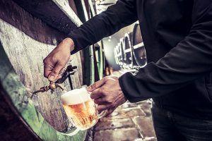 Tasting beer in cellars during visit of Pilsen brewery