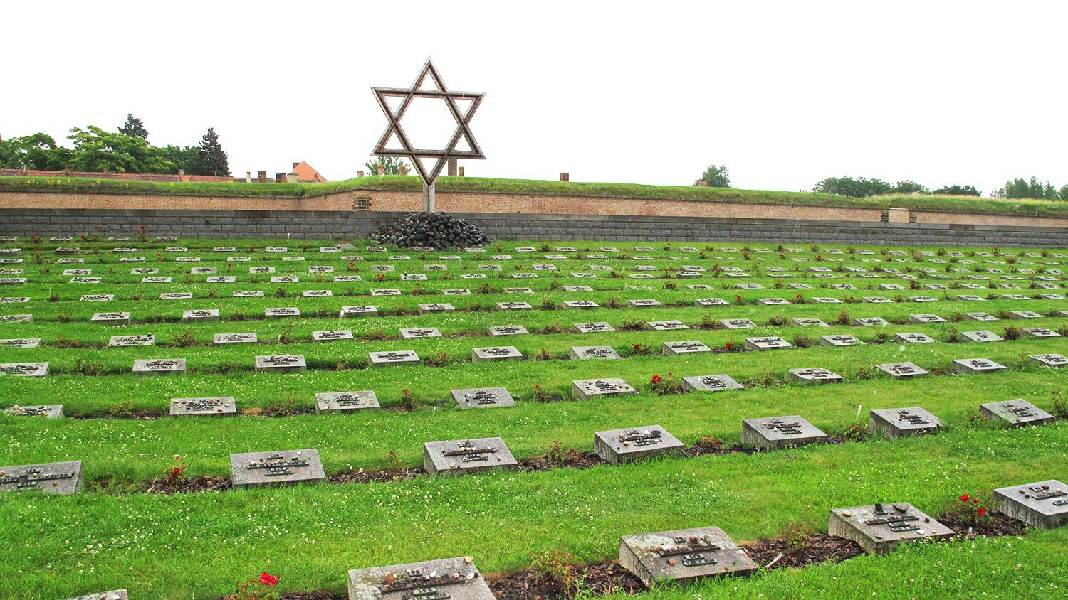 Terezin tour, cemetery with graves and Jewish star, Supreme Prague