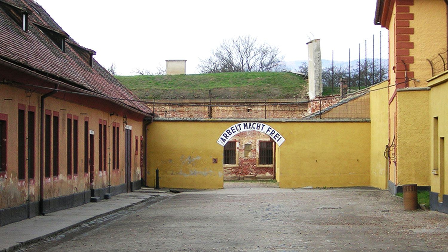 Tour to Terezin, sign Arbeit macht frei, Supreme Prague